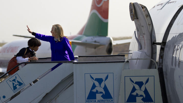 U.S. Secretary of State Hillary Rodham Clinton waves goodbye as she departs Nairobi, Kenya, on Sunday, Aug. 5, 2012, en route to Malawi. (AP Photo/Jacquelyn Martin, Pool)