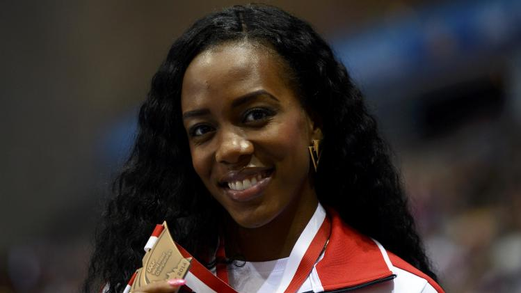 Bronze medallist Britain's Porter celebrates during victory ceremony for women's 60m hurdles at world indoor athletics championships in Sopot