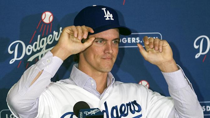 New Los Angeles Dodgers pitcher Zack Greinke adjusts his cap during a baseball news conference announcing his $147 million, six-year contract, Tuesday, Dec. 11, 2012, in Los Angeles. (AP Photo/Damian Dovarganes)