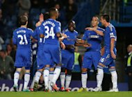 Victor Moses, centre, sealed Chelsea's victory over Wolves