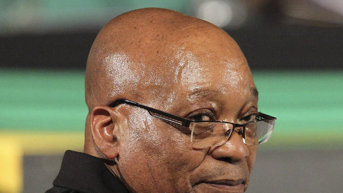 Ruling party African National Congress (ANC) president Jacob Zuma looks back over his shoulder, during the nominations for the new leadership of their elective conference at the University of the Free State in Bloemfontein, South Africa, on Monday, Dec. 17, 2012. South Africa's African National Congress, the nation's governing party, has begun accepting nominations for its top officials. At their meeting Monday, officials announced that there would be only two candidates contesting to be the party's president: Current President Jacob Zuma and Deputy President Kgalema Motlanthe. (AP Photo/Themba Hadebe)