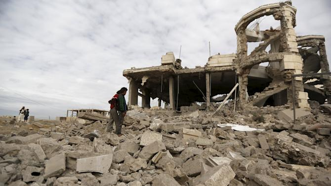 People look at the house of Ali Haidar, a Houthi leader, destroyed by a Saudi-led air strike in Sanaa, Yemen