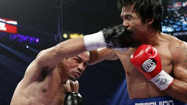 Juan Manuel Marquez lands a counter right on Manny Pacquiao during their fourth fight