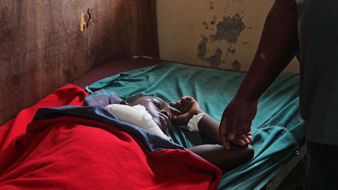 A young boy paralyzed by a shrapnel wound in his spine, lies in a bed at Heal Africa hospital in Goma, Congo, Tuesday, Nov. 20, 2012. A rebel group created just seven months ago seized the strategic provincial capital of Goma, home to more than 1 million people in eastern Congo, and its international airport on Tuesday, officials and witnesses said, raising the specter of a regional war. (AP Photo/Melanie Gouby)