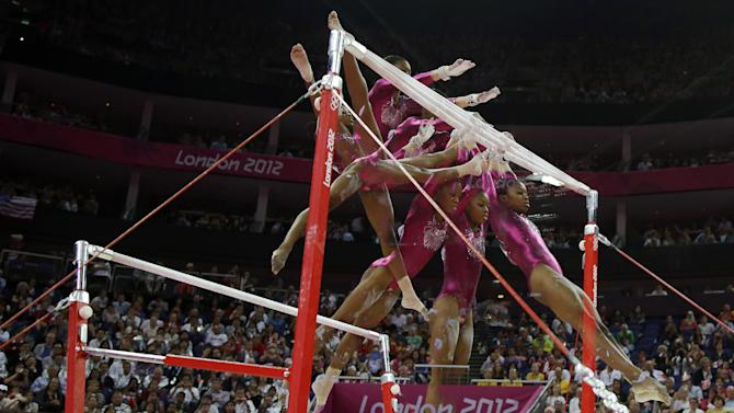 In this multiple exposure photo, U.S. gymnast Gabrielle Douglas performs on the uneven bars during the artistic gymnastics women's individual all-around competition at the 2012 Summer Olympics, Thursday, Aug. 2, 2012, in London. (AP Photo/Julie Jacobson)