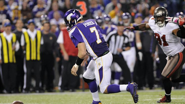 Minnesota Vikings quarterback Christian Ponder (7) fumbles the ball in front of Tampa Bay Buccaneers defensive end Da'Quan Bowers, right, during the second half of an NFL football game Thursday, Oct. 25, 2012, in Minneapolis. Ponder recovered the ball. (AP Photo/Jim Mone)