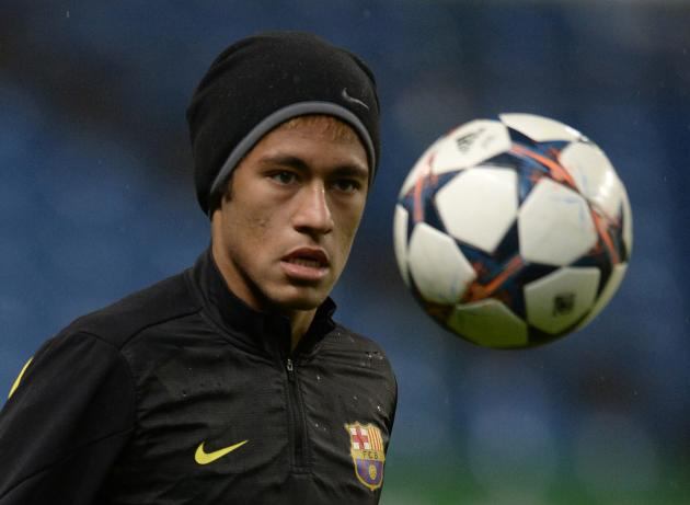 Barcelona's Neymar watches the ball during a training session at the Etihad Stadium in Manchester