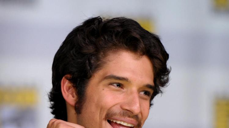 "Tyler Posey speaks during the ""Teen Wolf"" panel at the San Diego Convention Center on Day 2 of Comic-Con International on Thursday, July 18, 2013, in San Diego, Calif. (Photo by John Shearer/Invision for MTV/AP)"