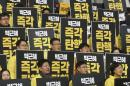 The Latest: SKorea ups military readiness after impeachment