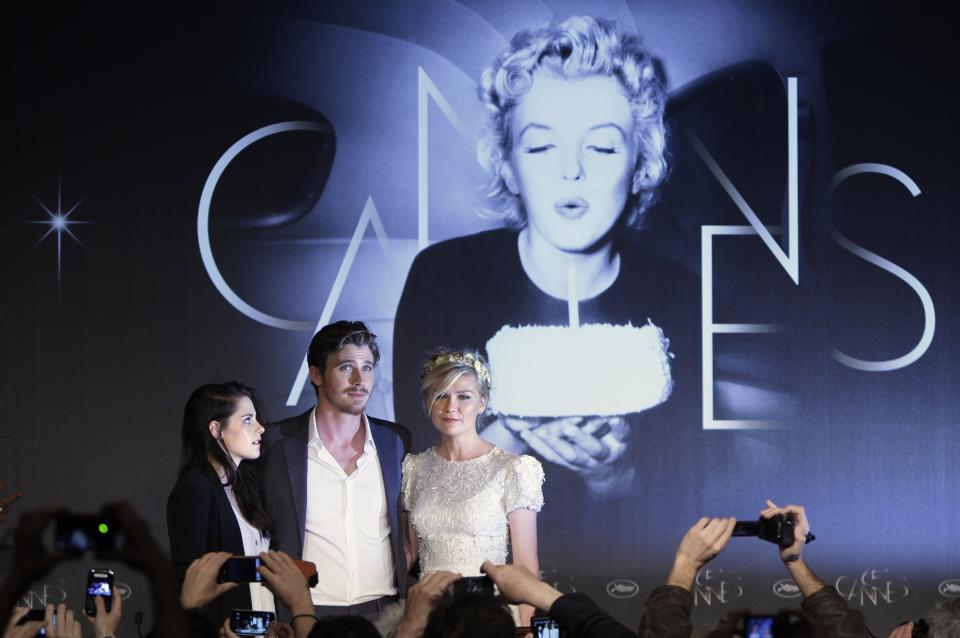 From left, actors Kristen Stewart, Garret Hedlund, and Kirsten Dunst pose during a press conference for On the Road at the 65th international film festival, in Cannes, southern France, Wednesday, May 23, 2012. (AP Photo/Francois Mori)