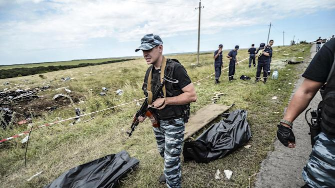 Armed pro-Russian separatists block the way to the crash site of Malaysia Airlines Flight MH17, near the village of Grabove on July 20, 2014