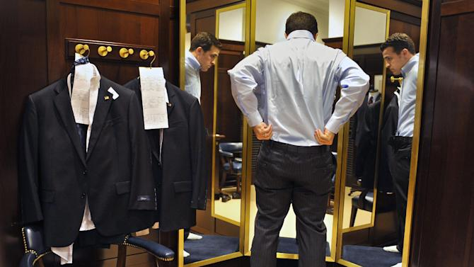 In this Thursday, Sept. 20, 2012 photo, Marine Corps veteran Cory Hixson of Springfield, Va. is fitted for a suit provided by Brooks Brothers in West Hartford, Conn. Hixson is participating in the University of Connecticut's Entrepreneurship Bootcamp for Veterans with Disabilities. More than 200,000 people are discharged from the U.S. military each year, and advocates say they often possess qualities that make good entrepreneurs: resourcefulness, a taste for risk-taking and a can-do attitude. Nonprofit groups, state governments and U.S. agencies are all providing business training aimed at giving them new purpose and easing their transition to civilian life. (AP Photo/Jessica Hill)