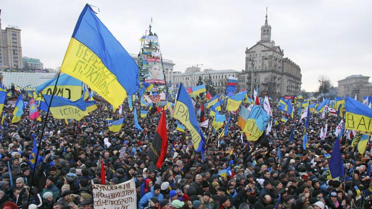People attend a rally organized by supporters of EU integration at Maidan Nezalezhnosti or Independence Square in central Kiev