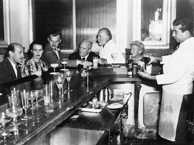 Ernest and Mary Hemingway with Spencer Tracy at the bar corner in El Floridita, Havana, Cuba, ca. 1955.