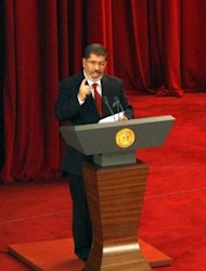 President Mohamed Morsi delivers a speech at Cairo&#39;s University after being sworn-in at the Constitutional Court in Cairo. Morsi pointedly mentioned the &quot;elected parliament&quot; several times and said the army should resume its normal role