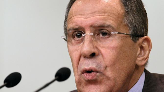 Russian Foreign Minister Sergey Lavrov speaks at a news conference in Moscow, Monday, July 16, 2012. Lavrov said Monday the Western threats to discontinue the 300-strong U.N. unarmed observer mission to Syria if Russia does not agree to allow the West to use force in the country amounts to blackmail. (AP Photo/Sergey Ponomarev)