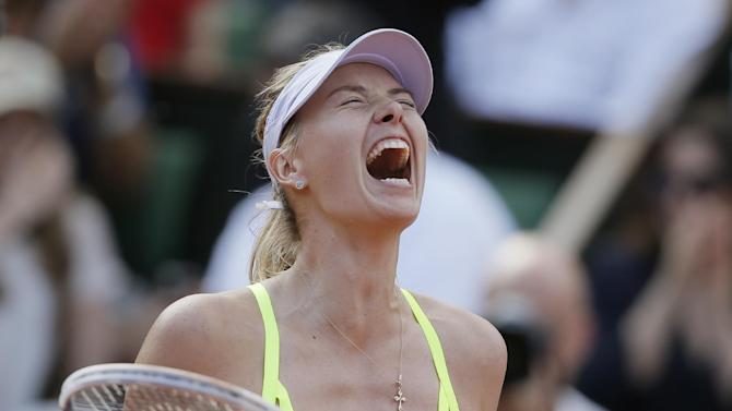 Russia's Maria Sharapova celebrates defeating Victoria Azarenka of Belarus in three sets 6-1, 2-6, 6-4, in their semifinal match at the French Open tennis tournament, at Roland Garros stadium in Paris, Thursday June 6, 2013. (AP Photo/Petr David Josek)