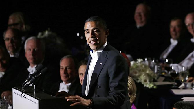 President Barack Obama speaks at the 67th annual Alfred E. Smith Memorial Foundation Dinner, a charity gala organized by the Archdiocese of New York, which was also attended by Republican presidential candidate and former Massachusetts Gov. Mitt Romney, Thursday, Oct. 18, 2012, at the Waldorf Astoria hotel in New York. (AP Photo/Charles Dharapak)