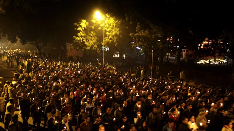 Indians hold candles and march on a street as they mourn the death of a gang rape victim in New Delhi, India, Saturday, Dec. 29, 2012. Indian police charged six men with murder on Saturday, adding to accusations that they beat and gang-raped the woman on a New Delhi bus nearly two weeks ago in a case that shocked the country. The murder charges were laid after the woman died earlier Saturday in a Singapore hospital where she has been flown for treatment. (AP Photo/Altaf Qadri)