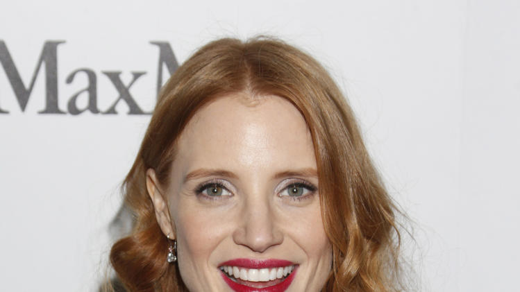 Jessica Chastain attends at the 6th Annual Women in Film Pre-Oscar cocktail party at Fig and Olive on Friday, Feb. 22, 2013 in Los Angeles. (Photo by Todd Williamson/Invision/AP)