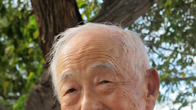 Herbert Yanamura, who served in the Military Intelligence Service during World War II, poses for a photo in Honolulu on Wednesday, Jan. 9, 2013. A national tour of the Congressional Gold Medal honoring Yanamura and other Japanese-American veterans will open in New Orleans on Saturday, Jan. 12, 2013. (AP Photo/Audrey McAvoy)