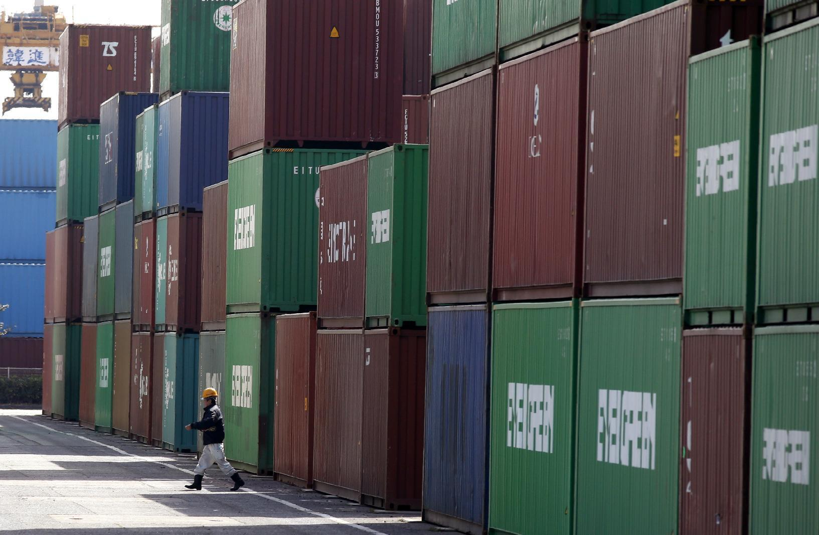 Japan sees trade surplus in June as imports drop 19 percent