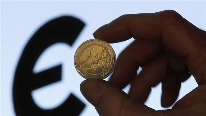A picture illustration shows a two euro coin outside the European Parliament in Brussels