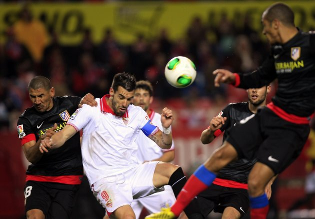 Sevilla's Negredo and Atletico Madrid's Diaz fight for the ball during their Spanish King's Cup semi-final second leg soccer match in Seville