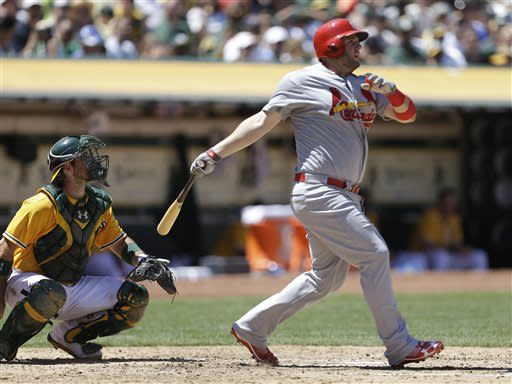 Wainwright wins 11th game, Adams homers twice