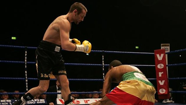 Scottish boxer Scott Harrsion knocks down Ethiopian Samuel Kebede
