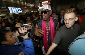 Former NBA basketball player Rodman is surrounded by journalists as he arrives at the Beijing Capital International Airport to leave for Pyongyang, in Beijing
