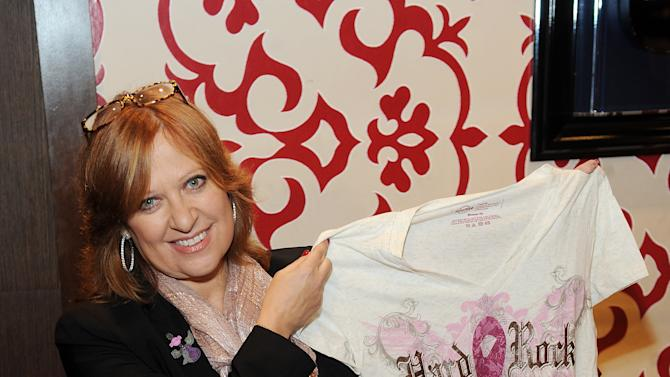 Caroline Manzo works in the Hard Rock Cafe Rock Shop in support of the 13th Annual Pinktober Breast Cancer Awareness Campaign, on Tuesday, Oct. 2, 2012 at Hard Rock Cafe, New York. (Photo by Scott Gries/Invision for Hard Rock/AP Images)
