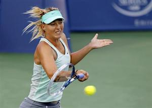 Sharapova of Russia hits a return to Stephens of the U.S. at the Women's Cincinnati Open tennis tournament in Cincinnati