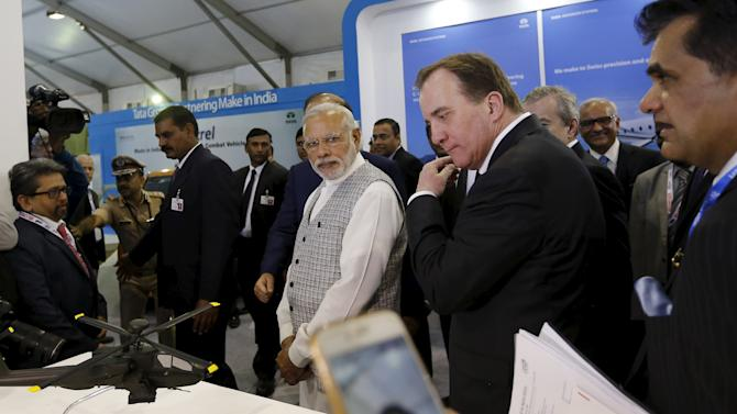 India's Prime Minister Narendra Modi and Sweden's Prime Minister Stefan Lofven visit a pavilion at the exhibition centre of the 'Make In India' week in Mumbai