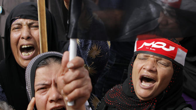 "Supporters of Egypt's military shout anti-Muslim Brotherhood slogans during a protest in front of the Unknown Soldier memorial in Cairo, Egypt, Friday, March 15, 2013. Hundreds of pro-military supporters gathered to reject the Muslim Brotherhood and President Mohammed Morsi's rule calling for the military to return to power. Arabic on the red scarf reads, ""Egypt."" (AP Photo/Amr Nabil)"