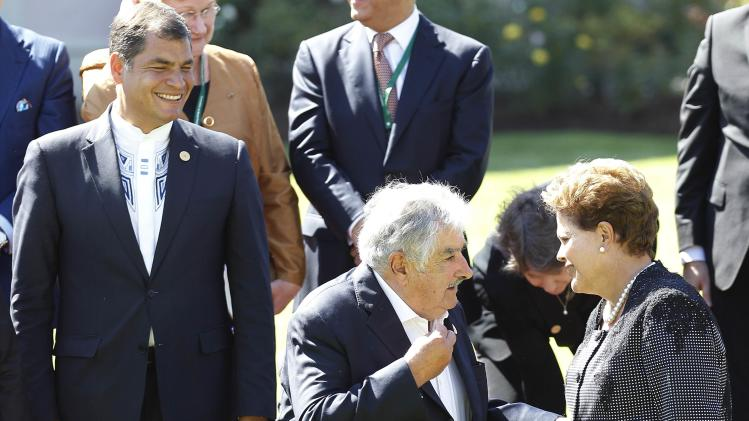 Brazil's president Rousseff speaks with Uruguay's president Mujica as Ecuador's president Correa smiles after a meeting at Cerro Castillo Presidential Palace with Chilean president Michelle Bachelet in Vina del Mar city