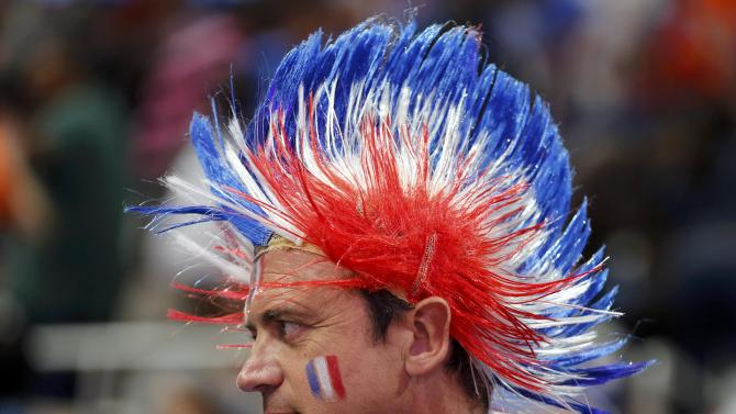 A French supporter attends the match of his team against Spain during their semi-final of the 24th Men's Handball World Championship in Doha