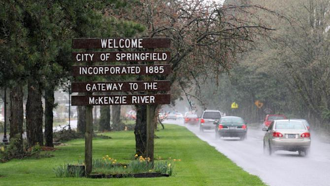 "A ""Welcome to Springfield"" is posted along a road in Springfield, Ore. Tuesday, April 10, 2012. One of the best-kept secrets in television history has been revealed, with ""The Simpsons"" creator Matt Groening pointing to Springfield, Ore., as the inspiration for the animated hometown of Homer and his dysfunctional family. Groening told Smithsonian magazine, published online Tuesday, that he was inspired by the television show ""Father Knows Best,"" which took place in a place called Springfield. Springfield, Ore., is 100 miles south of Groening's hometown of Portland. (AP Photo/Rick Bowmer)"