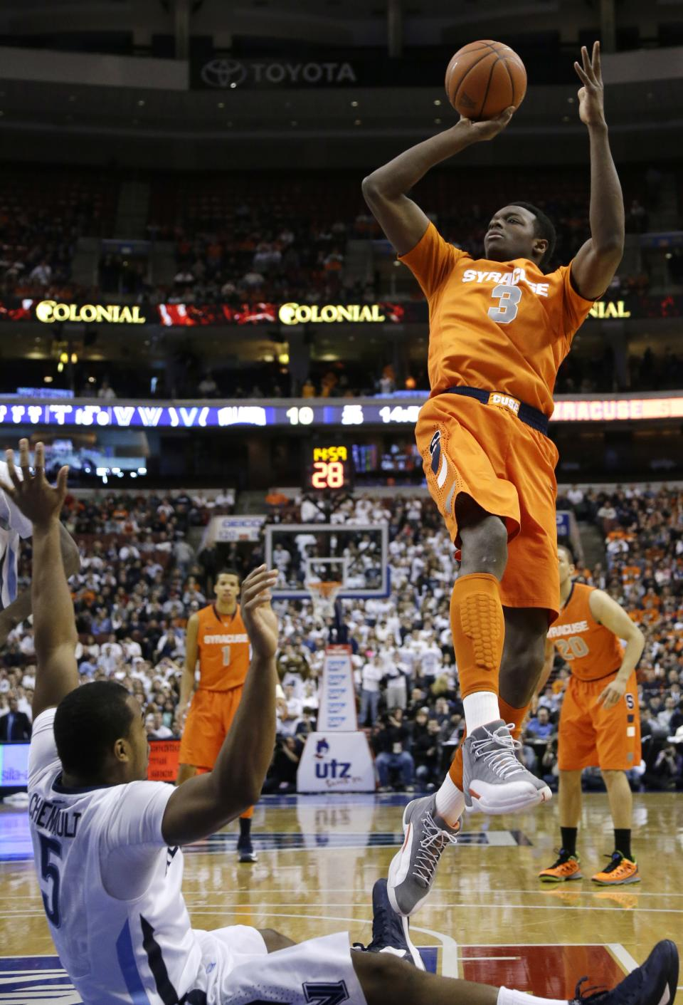 Syracuse's Jerami Grant, right, goes up for a shot against Villanova's Tony Chennault during the first half of an NCAA college basketball game, Saturday, Jan. 26, 2013, in Philadelphia. (AP Photo/Matt Slocum)