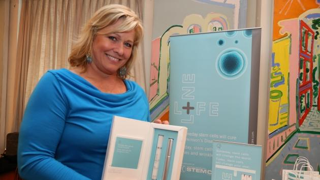 Emme with one of her favorite new skincare products for women Lifeline Stem Cell Skincare  --