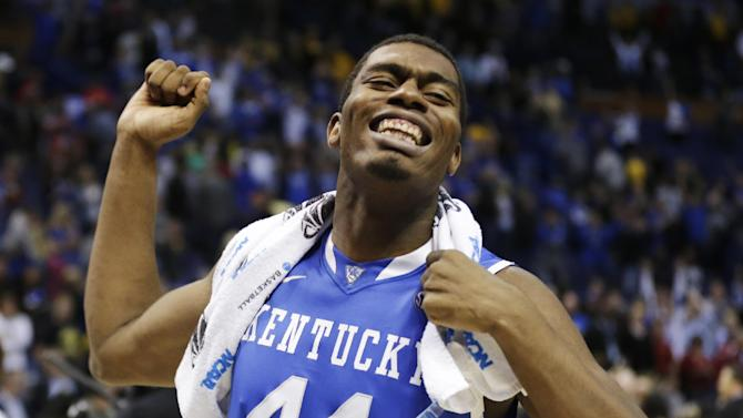 Kentucky center Dakari Johnson (44) celebrates after a third-round game against Wichita State at the NCAA college basketball tournament Sunday, March 23, 2014, in St. Louis. Kentucky won 78-76