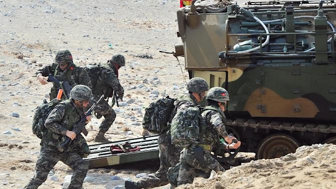 South Korean Marines exit an amphibious assault vehicle during a joint landing operation by US and South Korean Marines in Pohang, South Korea on March 31, 2014