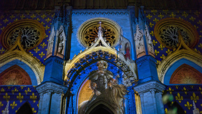 An artistic projection showing Joan of Arc is seen at Orlean's cathedral during ceremonies marking the 600th anniversary of the birth of Joan of Arc, in Orleans, central France, Sunday April 29, 2012. The city of Orleans goes all out with celebrations marking the 600th birthday of Joan of Arc, a national icon and symbol of French resistance through the ages at a time when French identity and France's role in the world are a focus in the presidential campaign.  (AP Photo/Thibault Camus)