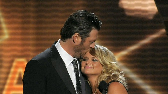 """Miranda Lambert, right, and Blake Shelton accept the award for song of the year for """"Over You"""" at the 48th Annual Academy of Country Music Awards at the MGM Grand Garden Arena in Las Vegas on Sunday, April 7, 2013. (Photo by Chris Pizzello/Invision/AP)"""