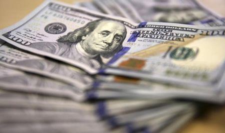 U.S. multinationals hit hard by strong dollar, to bleed further into 2015