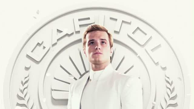 Peeta Mellark: Spirit of Strength Capitol Couture has been waiting eagerly for the next wave of incredible images of our cherished elite, and here they are! Fresh from the excitement of the most eventful Quarter Quell to date, we are thrilled and honored to present the new Capitol Citizen Living Portraits. As our Quarter Quell victors, Peeta Mellark and Johanna Mason hold the distinct honor of being the first Capitol citizens featured within a Living Portrait.  Peeta stands tall and true in his   Capitol Citizen Living Portrait , his matte leather Unconditional ensemble showcasing a stone-like texture and channeling the victor's quiet strength, completed by shirt and shoes courtesy of Maison Martin Margiela. The paper collar piece, designed by David Mason, mirrors the sculptural elements in Johanna's dress and gives a stern ambiance to the baker's son. With an unprecedented two victories under his belt, Peeta is no longer the boy who bravely faced the 74th Hunger Games, but a true Capitol hero.    Citizens can witness the artist's hand-selected series of Living Portraits in person at SOCA this summer.