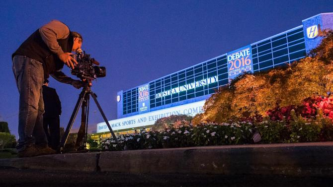 A television photographer captures the outside of the debate hall at Hofstra University in Hempstead, N.Y. Sunday, Sept. 25, 2016 the night before Republican presidential candidate Donald Trump and Democratic presidential candidate Hillary Clinton will meet in their first presidential debate. (AP Photo/J. David Ake)