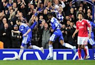 Chelsea's Frank Lampard (L) celebrates scoring a penalty against Benfica during their UEFA Champions League quarter finals football match at Stamford Bridge, West London. Chelsea reached the Champions League semi-finals here on Wednesday after beating 10-man Benfica 2-1 in their quarter-final second leg clash and 3-1 on aggregate