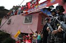Hugo Chavez coffin parades past Venezuela's ills