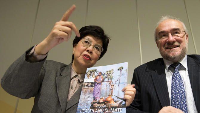 "Director General of the World Health Organization (WHO) Dr. Margaret Chan, left, and Secretary-General of the World Meteorological Organization (WMO) Michel Jarraud pose for the media with the Atlas Of Health And Climate, a manual which provides a practical guide to ""climate-sensitive diseases"" that decision-makers and leaders can use as a tool for prevention, during a presentation for the media at the International Conference Center in Geneva, Switzerland, Monday, Oct.  29, 2012. (AP Photo/Keystone/Salvatore Di Nolfi)"